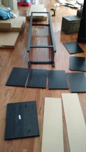 """A partially-assembled Ikea """"Hemnes"""" bookcase."""